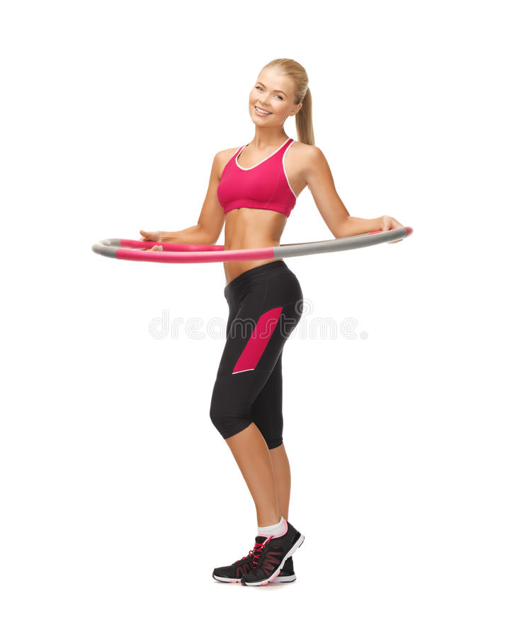 Young sporty woman with hula hoop stock photos