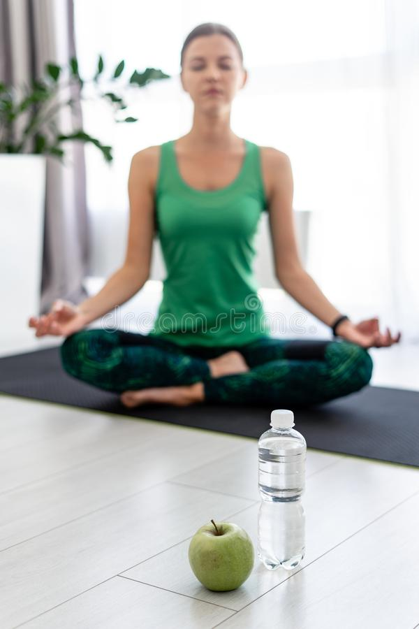 Free Young Sporty Woman In Meditation At Home Royalty Free Stock Image - 157177016