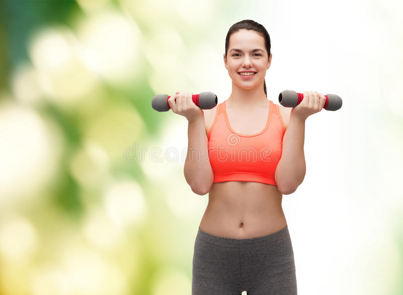 Download Young Sporty Woman With Light Dumbbells Stock Photo - Image: 40265966