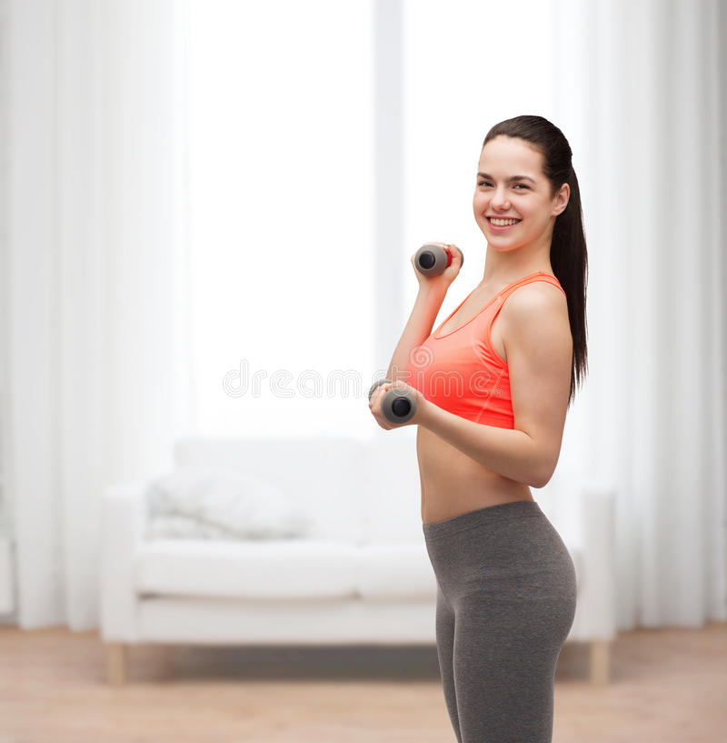 Download Young Sporty Woman With Light Dumbbells Stock Image - Image of latin, exercising: 40265991