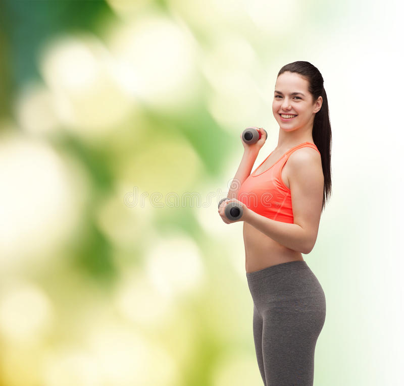 Download Young Sporty Woman With Light Dumbbells Stock Photo - Image: 40265992