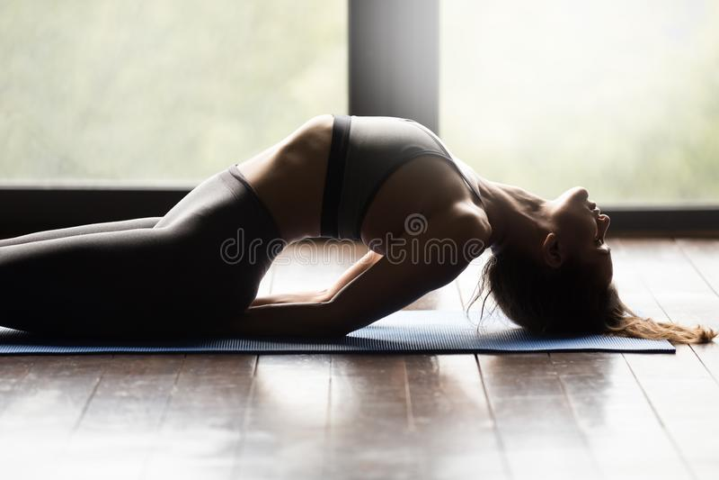 Young sporty woman doing Matsyasana exercise, close up stock image