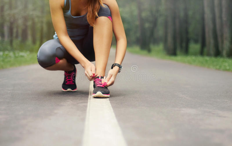 Download Young Sporty Woman Preparing To Run In Early Foggy Morning In Th Stock Photo - Image: 45696108