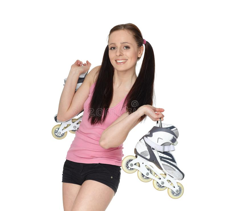 Young  sporty woman with rollerskates royalty free stock images