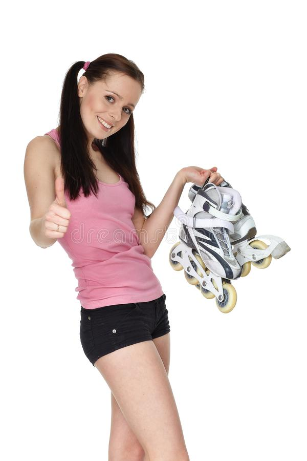 Young  sporty woman with rollerskates stock image