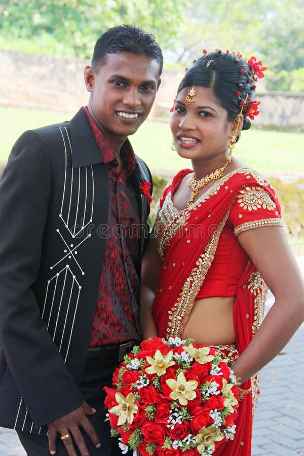 Young Sri Lankan married couple during their traditional `Homecoming` reception royalty free stock photo