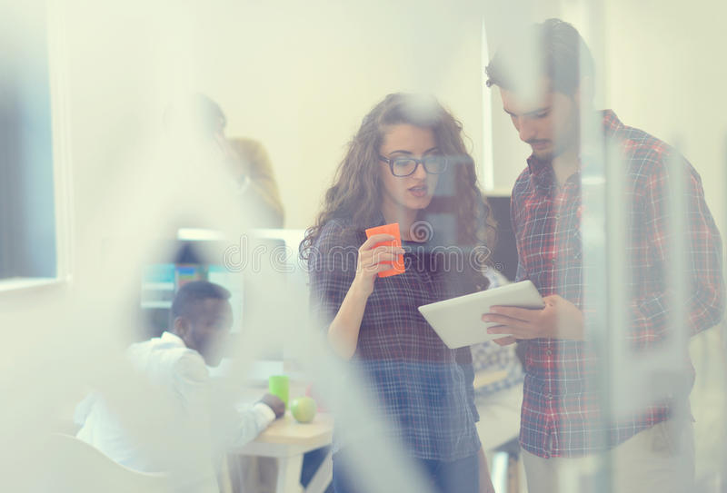 Young startup business people, couple working on tablet computer royalty free stock photos
