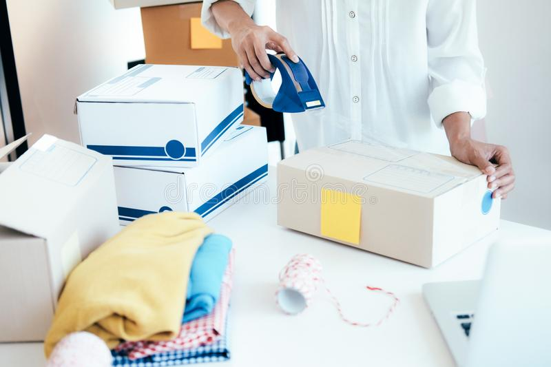 Young startup entrepreneur small business owner working at home, packaging and delivery situation. Business Start up SME concept. Young startup entrepreneur royalty free stock images