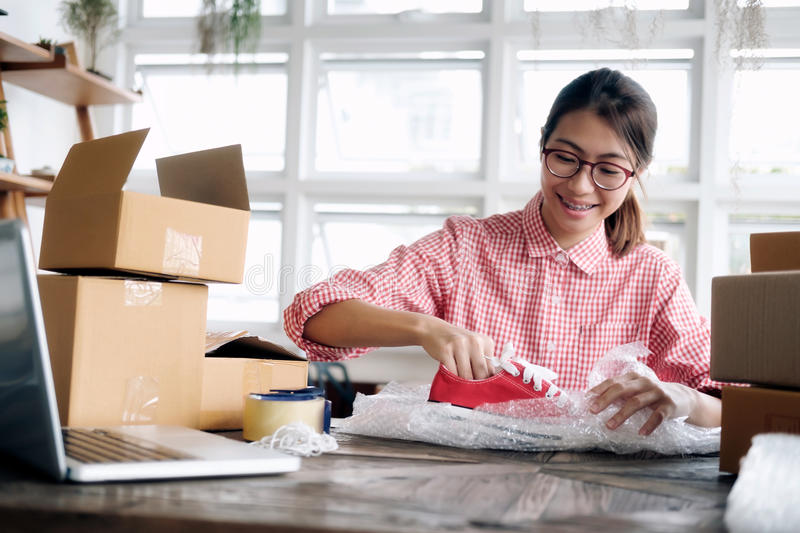 Young startup entrepreneur small business owner working at home, packaging and delivery situation. royalty free stock images
