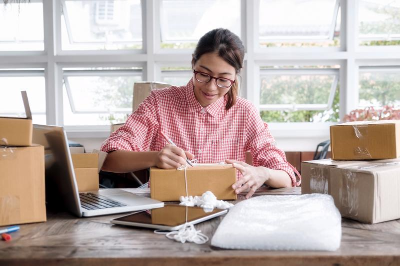 Young startup entrepreneur small business owner working at home, packaging and delivery situation. Business Start up SME concept. Young startup entrepreneur stock images