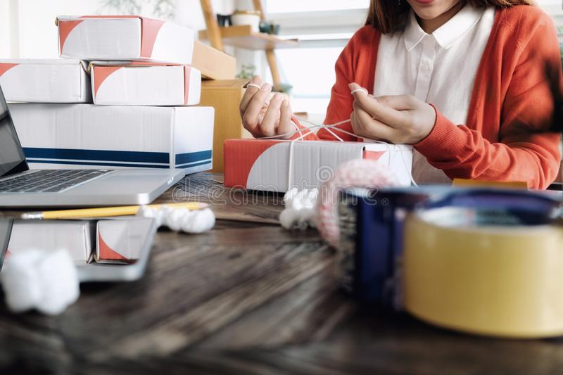 Young startup entrepreneur small business owner working at home, packaging and delivery situation. royalty free stock photos