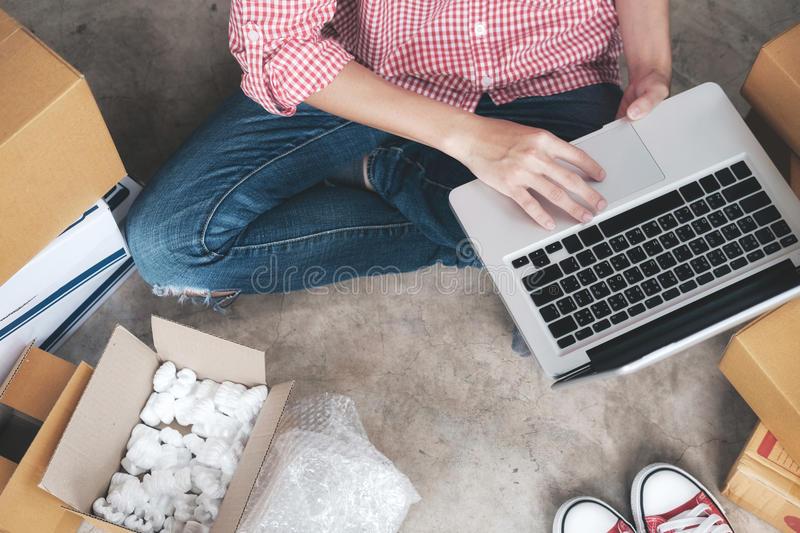 Young startup entrepreneur small business owner working at home, packaging and delivery situation. royalty free stock image