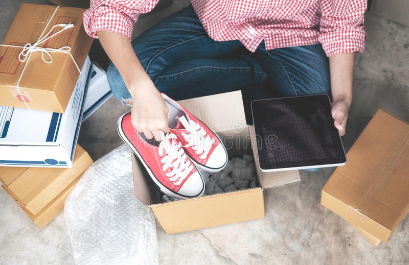 Young startup entrepreneur small business owner working at home, packaging and delivery situation. Business Start up SME concept. Young startup entrepreneur royalty free stock photo