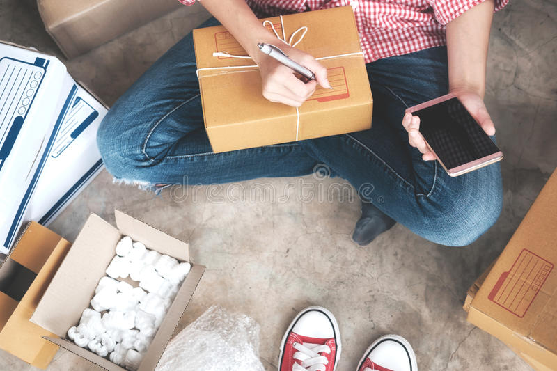 Young startup entrepreneur small business owner working at home, packaging and delivery situation. stock photo