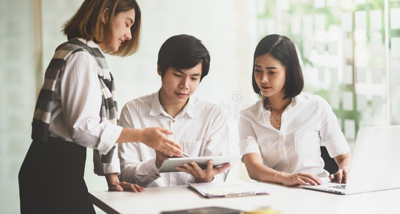 Young startup team brainstorming the marketing strategy royalty free stock image