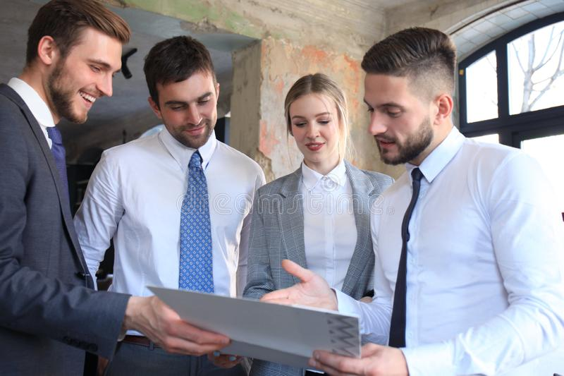 Young startups businessmen teamwork brainstorming meeting to discuss the investment.  royalty free stock image