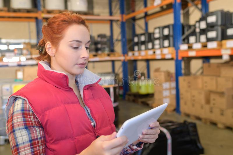 Young storage clerk reading tab stock photos
