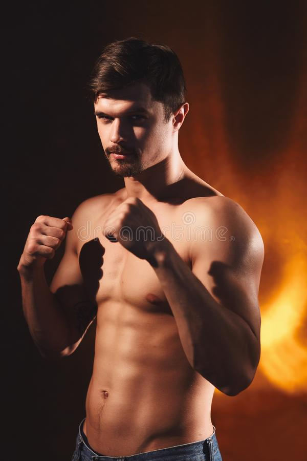 Young Street fighter over dark background stock photos