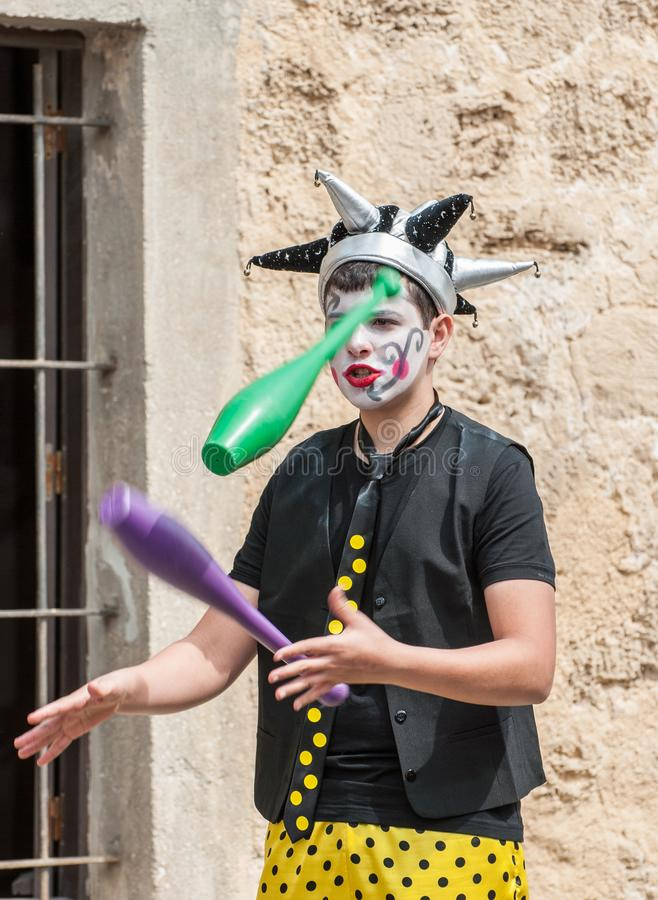 Young street juggler on Purim holiday at Tel Aviv`s Old Railway stock photography