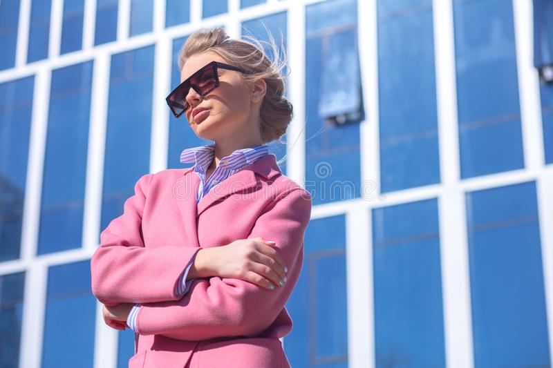 Young street woman hugging hersel outdoor royalty free stock image