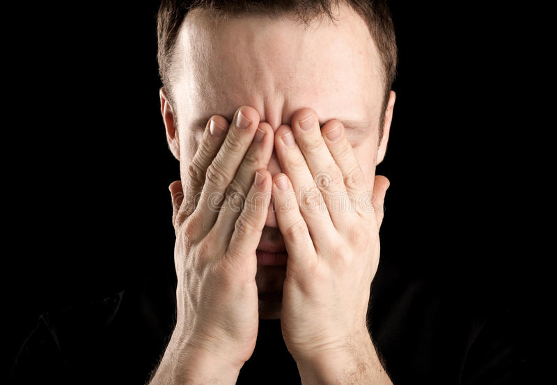 Young Stressed Man Covers His Face Royalty Free Stock Photo
