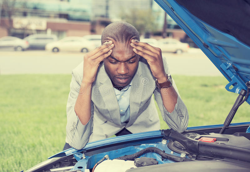 Young stressed man having trouble with his broken car royalty free stock images