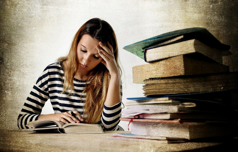 Young stressed student girl studying and preparing MBA test exam royalty free stock photo