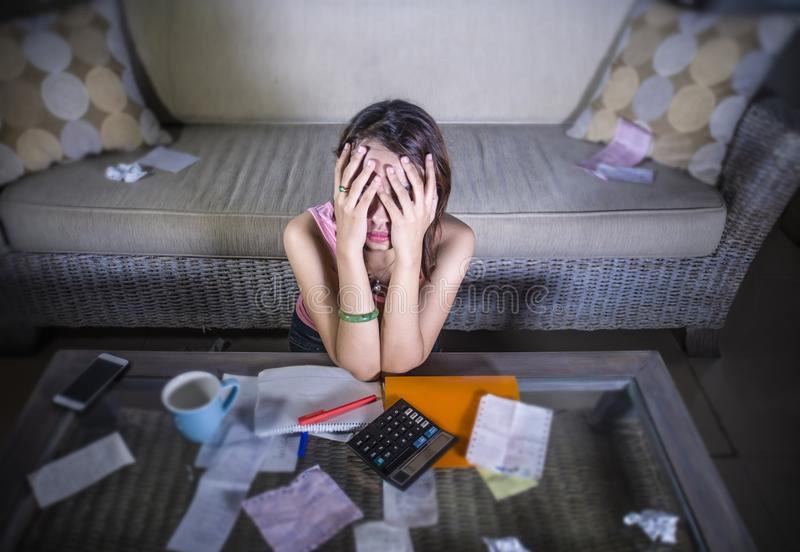 Young stressed and worried woman suffering stress calculating monthly expenses bills and debt in domestic accounting financial pro royalty free stock photos