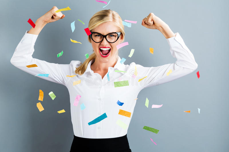 Young strong business woman celebrating. With confetti royalty free stock images