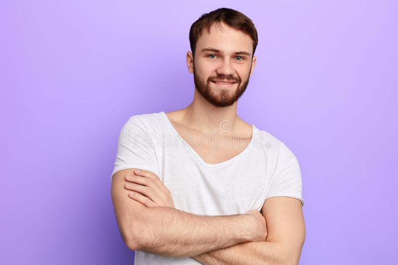 Young strong caucasian man standing with crossed arms stock images