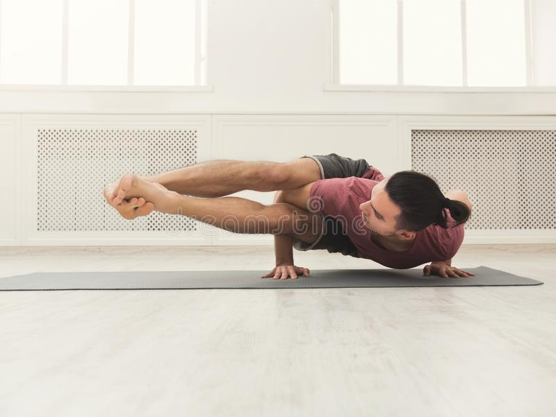 Young flexible man standing on hands royalty free stock images