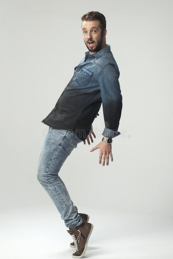 Young strong slim man in jeans shirt stock photo