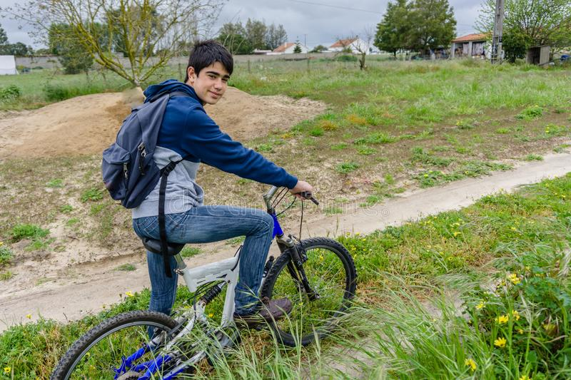 Young student with backpack and bicycle. Go to school. Copy spac. E for your text. Promotional content stock photo