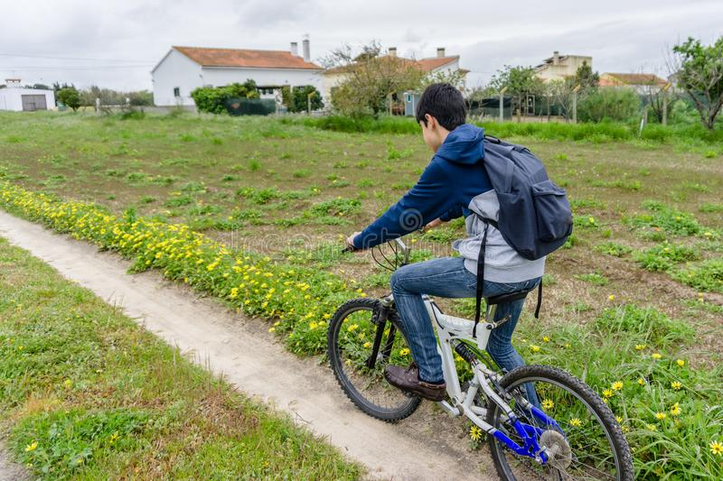 Young student with backpack and bicycle. Go to school. Copy spac. E for your text. Promotional content royalty free stock image
