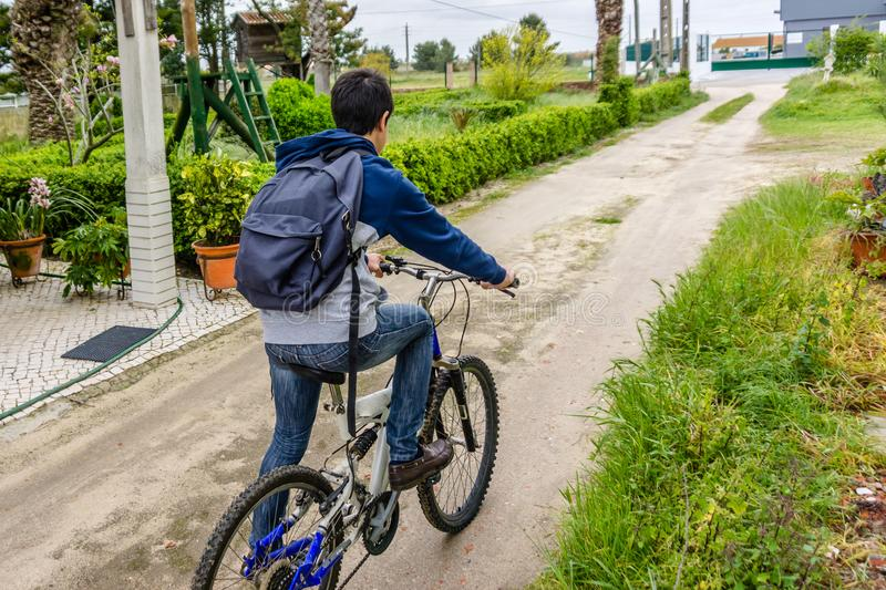 Young student with backpack and bicycle. Go to school. Copy spac. E for your text. Promotional content royalty free stock images