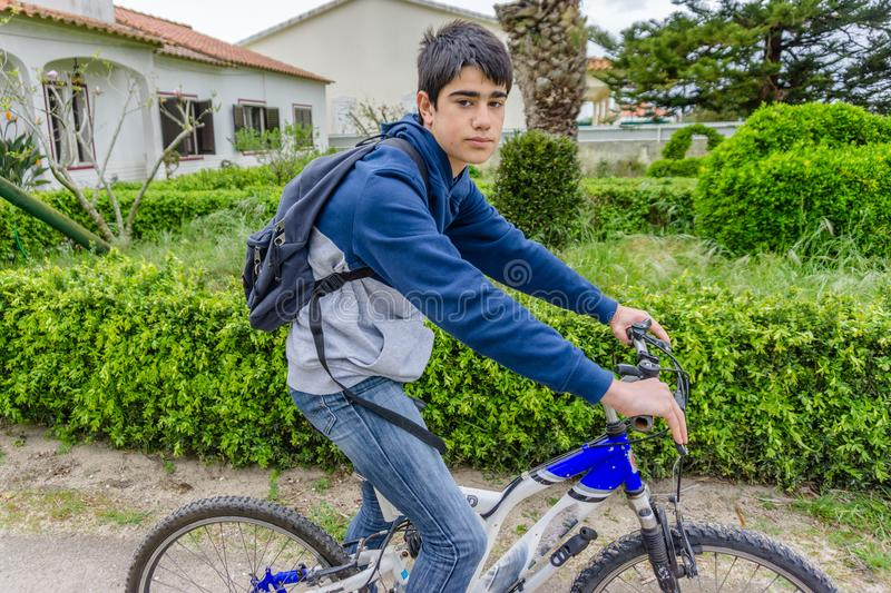 Young student with backpack and bicycle. Go to school. Copy spac. E for your text. Promotional content stock images