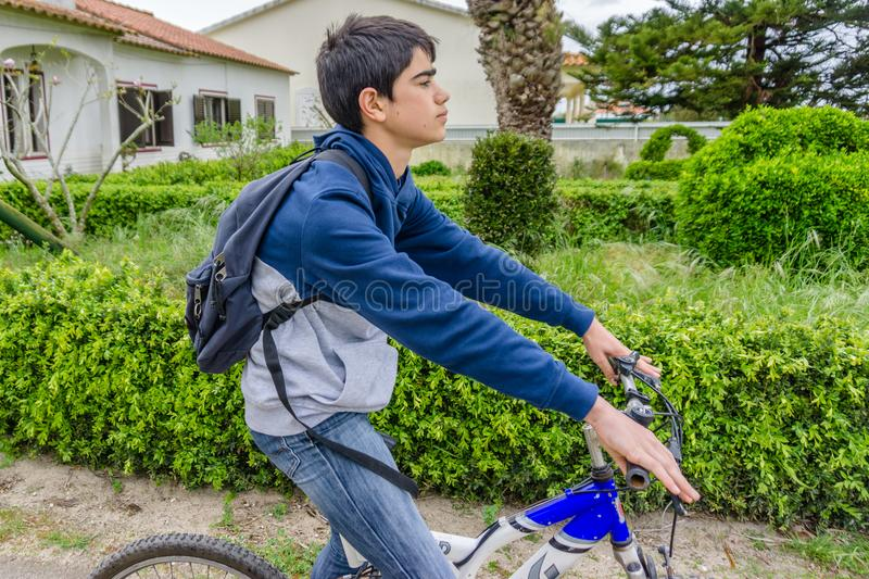 Young student with backpack and bicycle. Go to school. Copy spac. E for your text. Promotional content royalty free stock photography