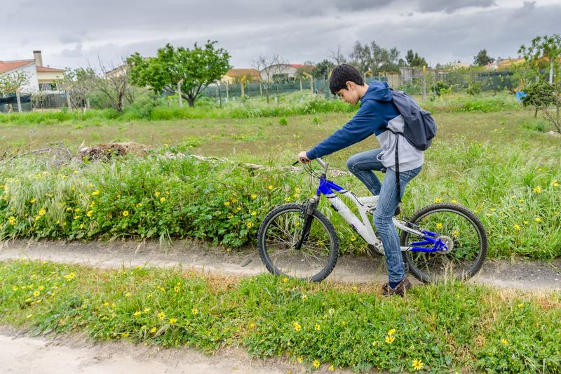 Young student with backpack and bicycle. Go to school. Copy spac. E for your text. Promotional content stock photos