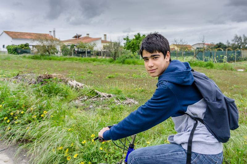 Young student with backpack and bicycle. Go to school. Copy spac. E for your text. Promotional content stock photography