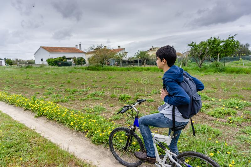 Young student with backpack and bicycle. Go to school. Copy spac. E for your text. Promotional content stock image