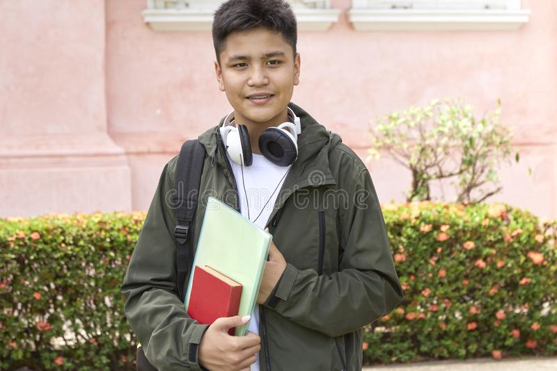 Young Student with Bag and Books stock photo