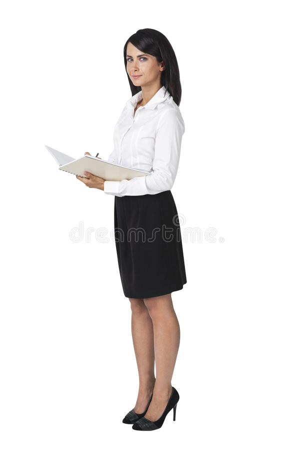 Young student business woman writing in notebook stock photo