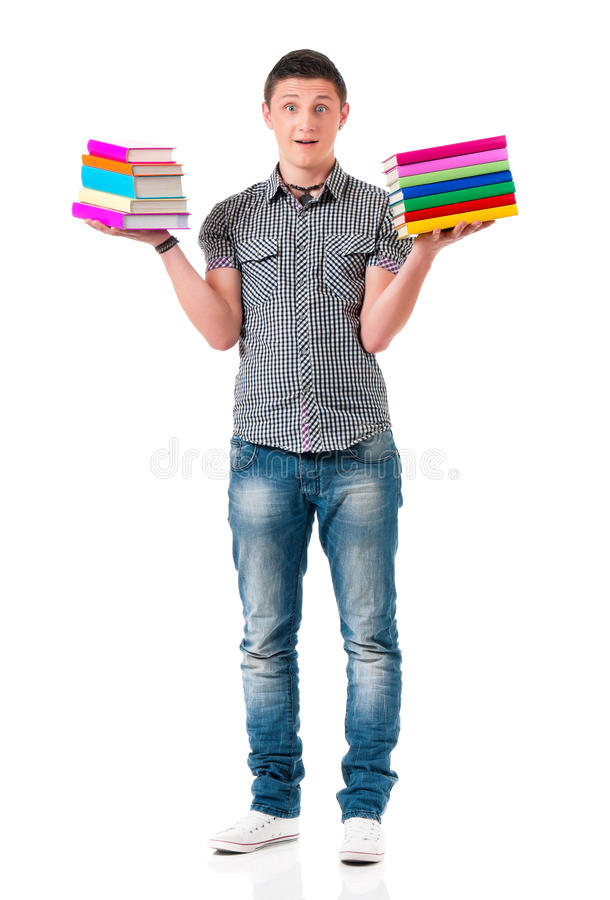 Young student carrying books stock image