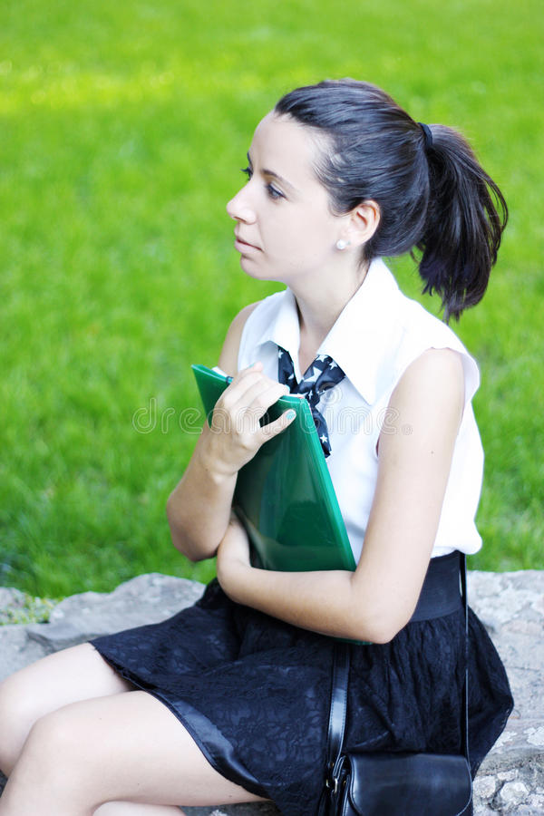 Download Young Student With Copybook Thinking Stock Photo - Image: 21483414