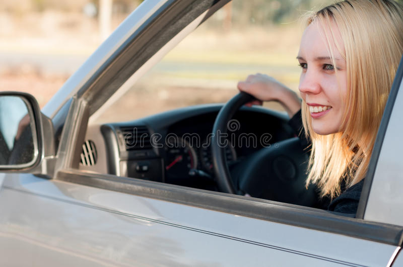 Young student girl driving a car stock photo