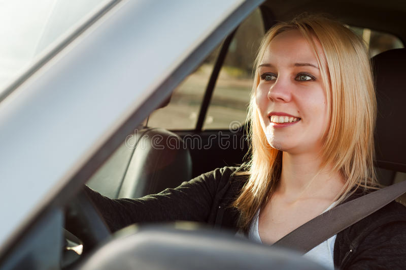Young student girl driving a car royalty free stock photography