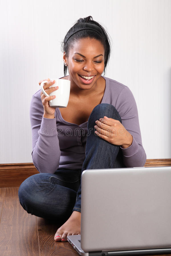 Young student girl at home using laptop online stock photos