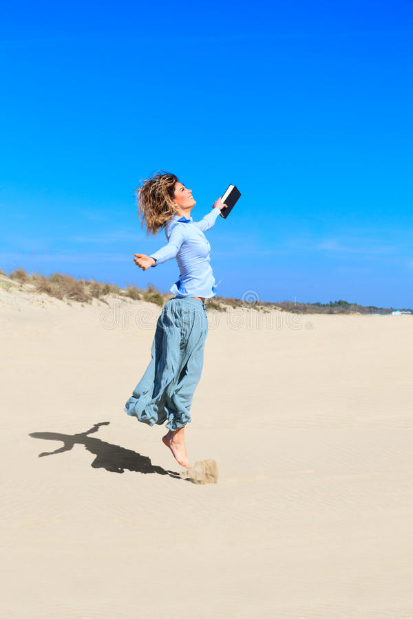 Download Young Student Girl Is Jumping Up In The Air Stock Photo - Image: 39553120