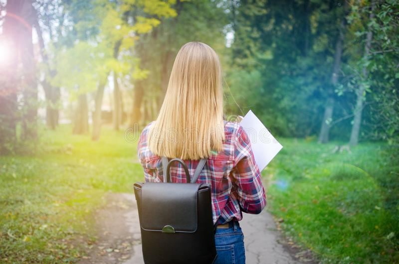 Young student girl walking in the park stock images