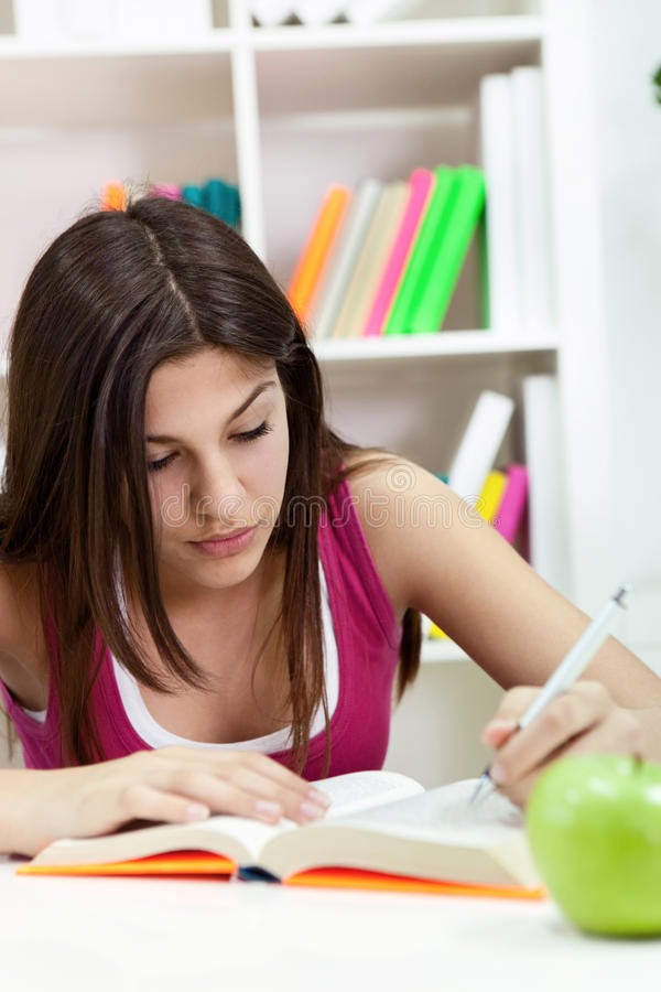 Young student girl writing royalty free stock image